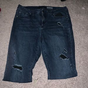 Dark blue distressed jeggings